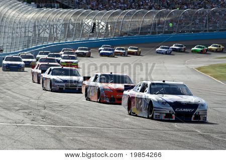 AVONDALE, AZ - APRIL 10: Scott Speed (#82) leads a group of cars out of turn two at the Subway Fresh Fit 600 NASCAR Sprint Cup race on April 10, 2010 in Avondale, AZ.