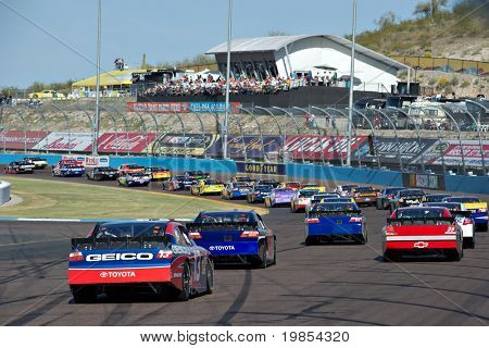 AVONDALE, AZ - APRIL 10: The field drives through turn two at the Subway Fresh Fit 600 NASCAR Sprint Cup race on April 10, 2010 in Avondale, AZ.