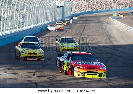 AVONDALE, AZ - APRIL 10: Jeff Gordon (#24) leads a group of cars into turn one at the Subway Fresh Fit 600 NASCAR Sprint Cup race on April 10, 2010 in Avondale, AZ.