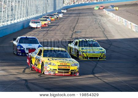 AVONDALE, AZ - APRIL 10: Clint Bowyer (#33) leads a group of cars into turn one at the Subway Fresh Fit 600 NASCAR Sprint Cup race on April 10, 2010 in Avondale, AZ.