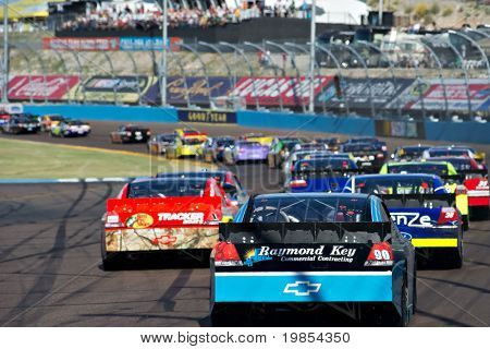 AVONDALE, AZ - APRIL 10: A group of cars drives through turn two at the Subway Fresh Fit 600 NASCAR Sprint Cup race on April 10, 2010 in Avondale, AZ.