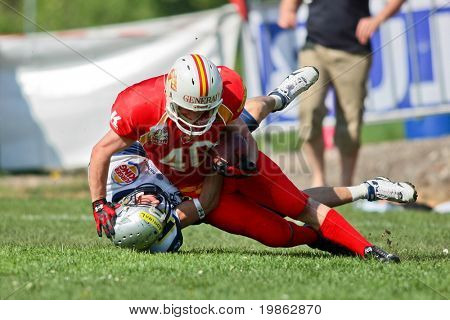 ST POELTEN,  AUSTRIA - APR 25: Austrian Football League - Divison I: SS Hannes Baumgartner (#40, Invaders) and his team win against the Traun Steelsharks  on April 25, 2009 in St. Poelten, Austria.