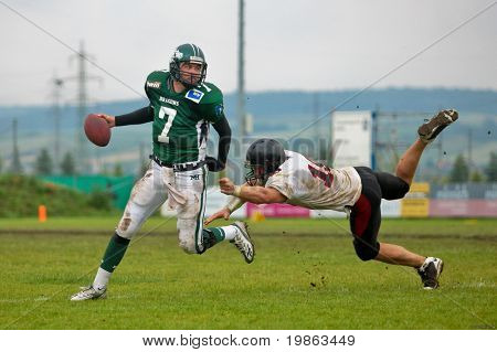KORNEUBURG,  AUSTRIA - JUNE 20 Austrian Football League: QB Ryan Rufener (#7, Dragons) and his team win 41:35 against the Carinthian Black Lions on June 20, 2009 in Korneuburg, Austria.