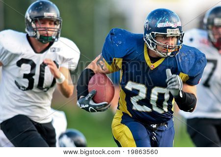 VIENNA,  AUSTRIA - JULY 4 Austrian Football League - Iron Bowl II: RB Lars Gabler (#20, Titans) and his team win 26:20 against the Vienna Knights on July 4, 2009 in Vienna, Austria.