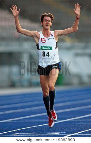 LINZ, AUSTRIA - AUGUST 1 Austrian track and field championship: Martin Steinbauer (#84) wins the men's 5000m race on August 1, 2009 in Linz, Austria.