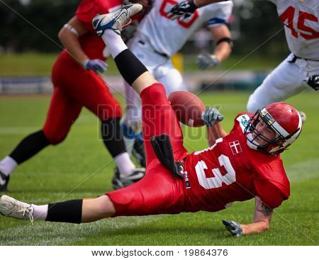 WOLFSBERG, AUSTRIA - AUGUST 18 American Football B-EC: WR Thomas Johansen (#13, Denmark) and his team lose 15:30 against Czech Republic on August 18, 2009 in Wolfsberg, Austria.