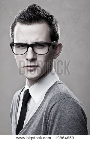 closeup portrait of handsome young adult wearing glasses