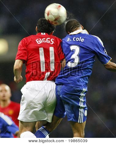 Ryan Giggs and Ashley Cole compete for a ball at the Champions League Final held at Luzhniki Stadium Moscow 21 May 2008 and contested by Manchester United v Chelsea FC