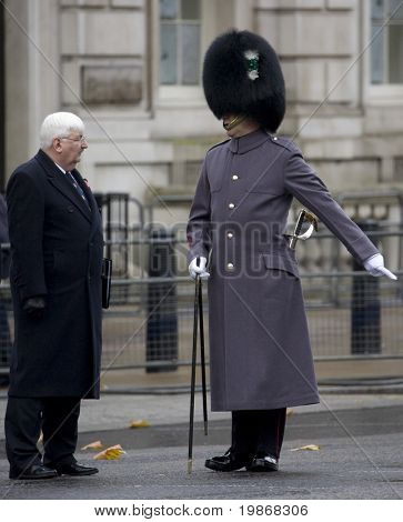 WHITEHALL, LONDON - NOV 8: The parade sergeant major instructs a city Alderman to his position at the Royal British Legion Remembrance Parade at the Cenotaph November 8, 2009 in Whitehall, London.