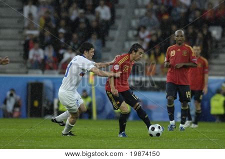 INNSBRUCK - JUNE 10: Yuri Zhirkov of Russia (in white) & Santi Cazorla of Spain (in red)  during the match Spain-Russia 4:1 Euro2008 Group D. June 10, 2008, in Innsbruck, Austria