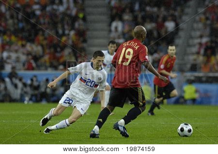 INNSBRUCK - JUNE 10: Marcos Senna of Spain (in red) & Igor Semshov of Russia (in white)  during the match Spain-Russia 4:1 Euro2008 Group D. June 10, 2008, in Innsbruck, Austria