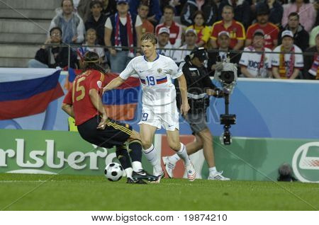 INNSBRUCK - JUNE 10: Sergio Ramos of Spain (in red) & Roman Pavlyuchenko of Russia (in white) during the match Spain-Russia 4:1 Euro2008 Group D. June 10, 2008, in Innsbruck, Austria