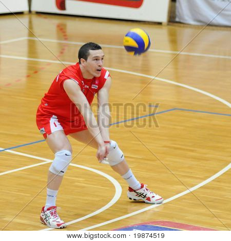 KAPOSVAR, HUNGARY - FEBRUARY 27: Juan Andres Ferreyra receives the ball in the Middle European League volleyball game between Kaposvar and Posojilnica , February 27, 2009 in Kaposvar, Hungary