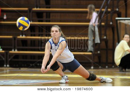 KAPOSVAR, HUNGARY - MARCH 1: Gabriella Kondor receives the ball in the Hungarian Extra League woman volleyball game between Kaposvar and BSE-FCSM , March 1, 2009 in Kaposvar, Hungary