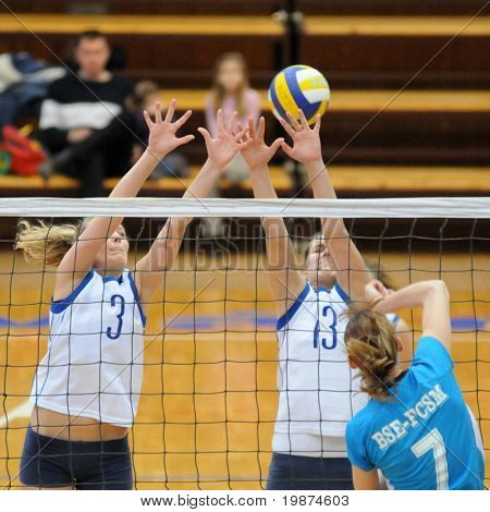 KAPOSVAR, HUNGARY - MARCH 1: Gabriella Kondor and Gabriella Serak blocks the ball in the Hungarian Extra League woman volleyball game between Kaposvar and BSE-FCSM , March 1, 2009 in Kaposvar, Hungary