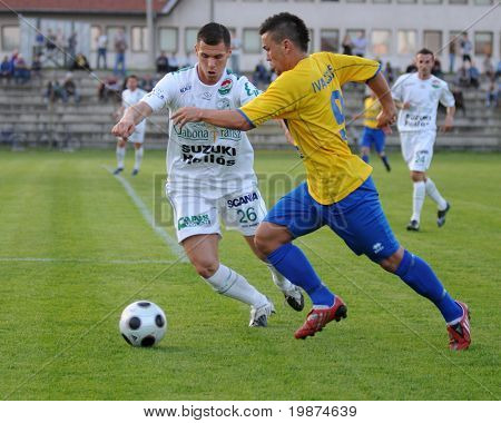 SIOFOK, HUNGARY - APRIL 25: Tamas Gruz and Gellert Ivancsics in action at Hungarian National Championship soccer game between BFC Siofok and Kaposvari Rakoczi FC April 25, 2009 in Siofok, Hungary.