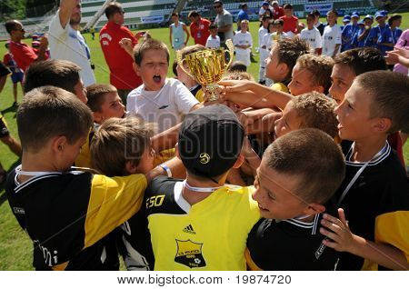 KAPOSVAR, HUNGARY - JULY 24: The winner romanian players are glad at the V. Youth Football Festival Under 9 Final - Atletico Arad (ROM) vs FC Goldstein (GER) - July 24, 2009 in Kaposvar, Hungary