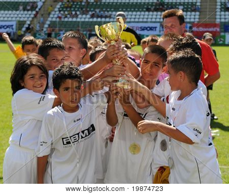 KAPOSVAR, HUNGARY - JULY 24: The second-place german players are glad at the V. Youth Football Festival Under 9 Final - Atletico Arad (ROM) vs FC Goldstein (GER) - July 24, 2009 in Kaposvar, Hungary