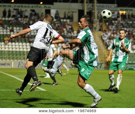 KAPOSVAR, HUNGARY - AUGUST 2: Peter Toth (L) and Krisztian Farkas in action at Hungarian National Championship soccer game Kaposvar vs Szombathely August 2, 2009 in Kaposvar, Hungary.