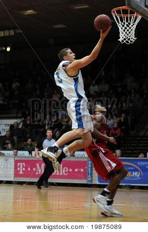 KAPOSVAR, HUNGARY - JANUARY 7: David Vojvoda (in white) in action at Hungarian National Championship basketball game between Kaposvar and Paks , January 7, 2009 in Kaposvar, Hungary.