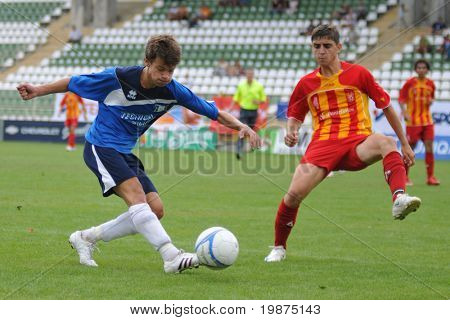 KAPOSVAR, HUNGARY - JULY 25: Unidentified players in action at the V. Youth Football Festival Under 17 Final - Pantelimon Bucuresti (Romania) vs Bresscia SC (Italy) July 25, 2009 in Kaposvar, Hungary