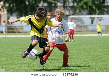 KAPOSVAR, HUNGARY - JULY 20: Unidentified players in action at the V. Youth Football Festival Under 10 match Cantolao (PER) vs Presov (SVK) July 20, 2009 in Kaposvar, Hungary