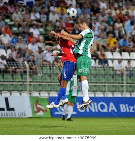 KAPOSVAR, HUNGARY - AUGUST 15: Attila Zabos (L) and Srdan Stanic in action at Hungarian National Championship soccer game Kaposvar vs Nyiregyhaza August 15, 2009 in Kaposvar, Hungary.