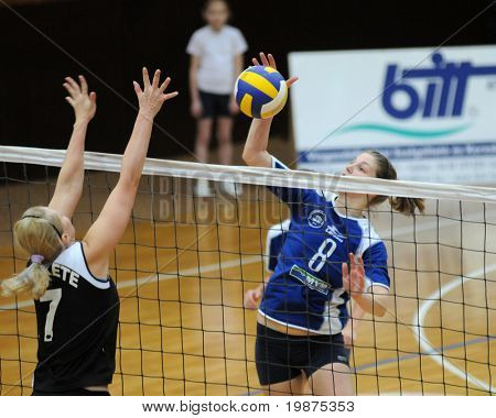 KAPOSVAR, HUNGARY - FEBRUARY 7: Timea Kondor strikes the ball in the Hungarian Extra League woman volleyball game between Kaposvar and UTE Volley , February 7, 2009 in Kaposvar, Hungary.