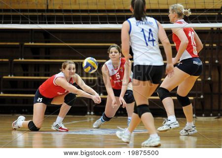 KAPOSVAR, HUNGARY - FEBRUARY 4: Orsolya Tormasi (8) and Lilla Porubek (5) receives the ball in the Hungarian Cup woman volleyball game Kaposvar vs Vasas, February 4, 2009 in Kaposvar, Hungary.