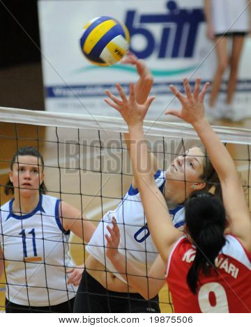 KAPOSVAR, HUNGARY - FEBRUARY 4: Timea Kondor (C) strikes the ball in the Hungarian Cup woman volleyball game Kaposvar vs Vasas, February 4, 2009 in Kaposvar, Hungary.