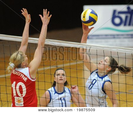 KAPOSVAR, HUNGARY - FEBRUARY 4: Timea Kondor (R) strikes the ball in the Hungarian Cup woman volleyball game Kaposvar vs Vasas, February 4, 2009 in Kaposvar, Hungary.
