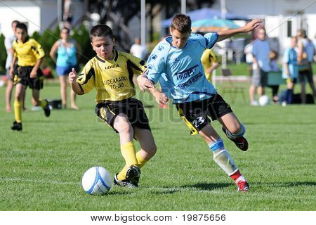 KAPOSVAR, HUNGARY - JULY 20: Unidentified players in action at the V. Youth Football Festival soccer game held July 20, 2009 in Kaposvar, Hungary.