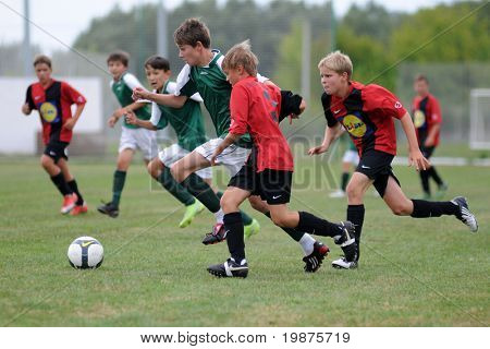 KAPOSVAR, HUNGARY - AUGUST 12: Unidentified soccer players in action at the Hungarian National Championship under 13 game between Kaposvari Rakoczi FC and Sopron SC August 12, 2009 in Kaposvar.