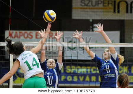 KAPOSVAR, HUNGARY - DECEMBER 17: Antonia Kiss(10) and Timea Kondor (8) blocks te ball at the Hungarian Extra League volleyball game Kaposvar vs Miskolc , December 17, 2008 in Kaposvar, Hungary.
