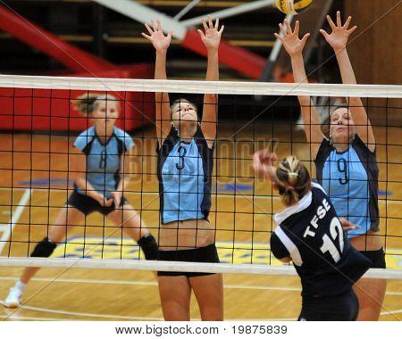 KAPOSVAR, HUNGARY - SEPTEMBER 13: Zsofia Harmath (3) and Rebeka Rak (9) blocks the ball in the Hungarian Extra League woman volleyball game Kaposvar vs TFSE, September 13, 2009 in Kaposvar, Hungary