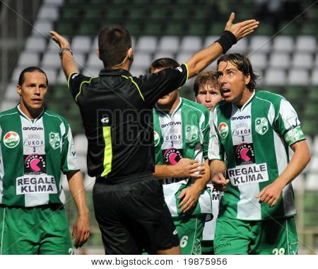 KAPOSVAR, HUNGARY - SEPTEMBER 25: The Kaposvar players complain to the referee at a Hungarian National Championship soccer game Kaposvar vs Debrecen September 25, 2009 in Kaposvar, Hungary.