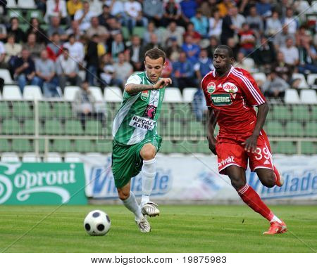 KAPOSVAR, HUNGARY - SEPTEMBER 25: Hegedus (L) and Coulibaly (R) in action at a Hungarian National Championship soccer game Kaposvar vs Debrecen September 25, 2009 in Kaposvar, Hungary.