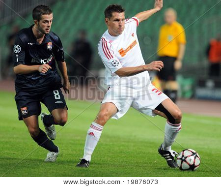 BUDAPEST - SEPTEMBER 29: Pjanic (8) and Zoltan Kiss in action at the UEFA Champions League football game Debrecen vs Lyon, UEFA Champions League football game, September 29, 2009 in Budapest, Hungary.