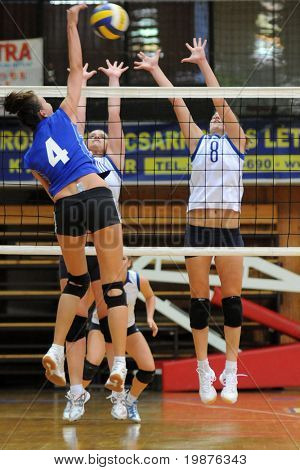 KAPOSVAR, HUNGARY - SEPTEMBER 20: Chovan(4) Palfy (C), and Kondor (8) in action at the Hungarian Extra League woman volleyball game Kaposvar vs Palota, September 20, 2009 in Kaposvar, Hungary