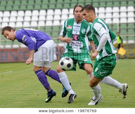 KAPOSVAR, HUNGARY - OCTOBER 17: Rajczi (L), Zahorecz (C) and Gruz in action at a Hungarian National Championship soccer game Kaposvar vs Ujpest October 17, 2009 in Kaposvar, Hungary.
