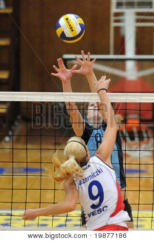 KAPOSVAR, HUNGARY - OCTOBER 11: Timea Kondor (8) and Jezerniczki (9) in action at the Hungarian NB I. League woman volleyball game Kaposvar vs Veszprem, October 11, 2009 in Kaposvar, Hungary.