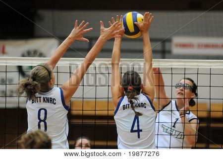 KAPOSVAR, HUNGARY - OCTOBER 14: Kondor (8), Czmerk (4) and Nemeth (1) in action at the Hungarian Cup woman volleyball game Kaposvar vs Godollo, October 14, 2009 in Kaposvar, Hungary.