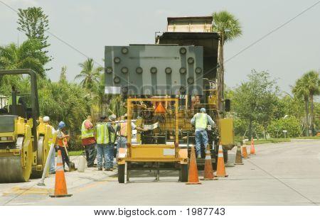 Construction Workers Repairing Road