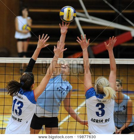 KAPOSVAR, HUNGARY - OCTOBER 25: Toth (L), Kondor (C), and Dancs (R) in action at the Hungarian NB I. League woman volleyball game Kaposvar vs Eger, October 25, 2009 in Kaposvar, Hungary.