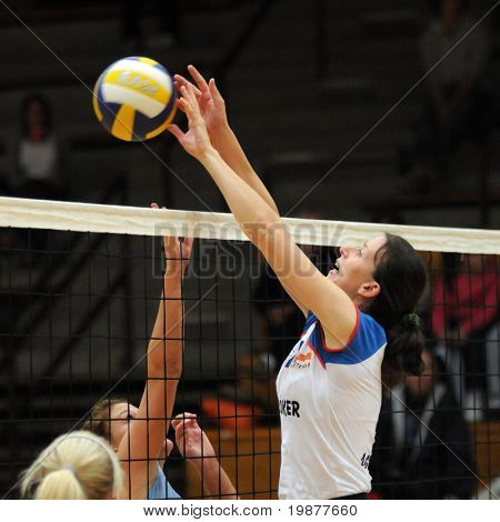 KAPOSVAR, HUNGARY - OCTOBER 25: Zacharne (R) in action at the Hungarian NB I. League woman volleyball game Kaposvar vs Eger, October 25, 2009 in Kaposvar, Hungary.