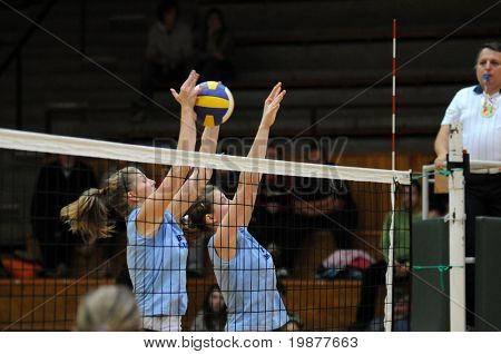 KAPOSVAR, HUNGARY - OCTOBER 25: Timea Kondor (L) and Rebeka Rak (L) blocks the ball at the Hungarian NB I. League woman volleyball game Kaposvar vs Eger, October 25, 2009 in Kaposvar, Hungary.