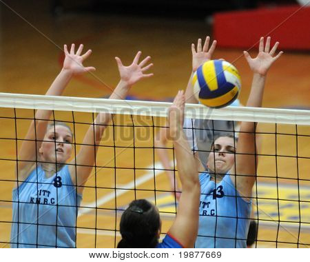 KAPOSVAR, HUNGARY - OCTOBER 25: Timea Kondor (8) and Gabriella Kondor (13) blocks the ball at the Hungarian NB I. League woman volleyball game Kaposvar vs Eger, October 25, 2009 in Kaposvar, Hungary.