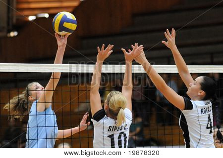 KAPOSVAR, HUNGARY - NOVEMBER 15: T. Kondor (L), Sipos (C) and Kovacs (R) in action at the Hungarian NB I. League woman volleyball game Kaposvar vs Nyiregyhaza, November 15, 2009 in Kaposvar, Hungary.