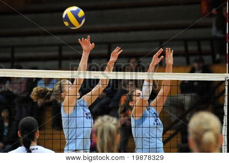 KAPOSVAR, HUNGARY - NOVEMBER 15: T. Kondor (L) and G. Kondor (R) blocks the ball at the Hungarian NB I. League woman volleyball game Kaposvar vs Nyiregyhaza, November 15, 2009 in Kaposvar, Hungary.