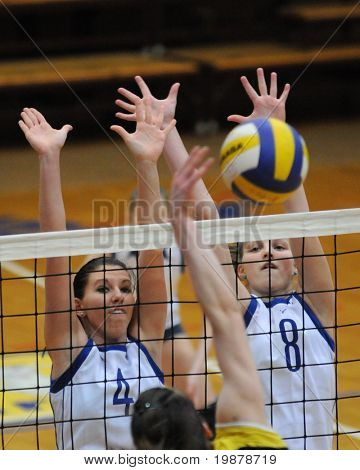 KAPOSVAR, HUNGARY - JANUARY 17: Czmerk (4) and Kondor T. (8) block the ball at the Hungarian NB I. League woman volleyball game Kaposvar vs Eger, January 17, 2010 in Kaposvar, Hungary.